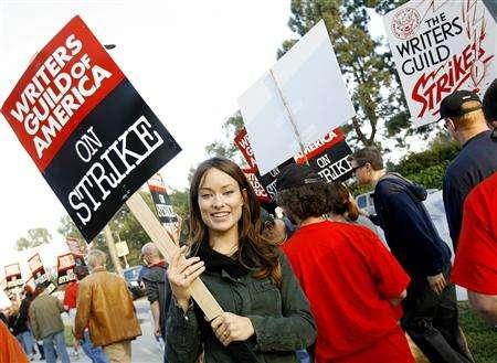 Actress Olivia Wilde, star of the Fox TV network series ''House M.D.'', walks a picket line along with members of the Writers Guild of America at one of the gates to Fox Studios in Los Angeles, California November 5, 2007. Fox on Wednesday became the first broadcast network to announce a strike-affected midseason schedule, revealing that ''24'' would not air at all this season. REUTERS/Mario Anzuoni