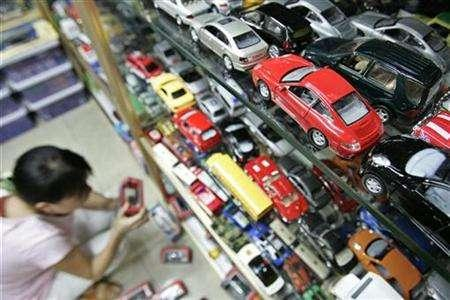 A shopper select toys at a store in Shanghai August 24, 2007. The European Union and the United States want new global toy safety rules to stem a surge of dangerous exports from countries like China, EU officials said. REUTERS/Aly Song