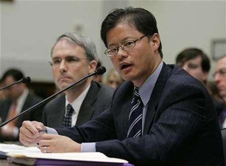 CEO of Yahoo! Inc. Jerry Yang testifies with Yahoo General Counsel Michael Callahan (L) before U.S. House Foreign Affairs Committee hearing on Capitol Hill in Washington November 6, 2007. Yahoo has agreed to settle a lawsuit brought on behalf of several Chinese dissidents for the Internet company's alleged involvement in providing information the Chinese government used to prosecute the men, according to court papers filed on Tuesday. REUTERS/Hyungwon Kang