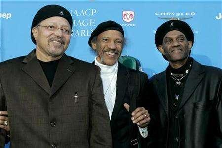 Three of the Neville Brothers music group Art, Charles and Cyril Neville (L-R) pose as they arrive at the taping of the 37th annual NAACP Image Awards in Los Angeles, California February 25, 2006. The Neville Brothers plan to play their hometown of New Orleans next year for the first time since Hurricane Katrina in 2005, giving hope others may return to the ravaged city. REUTERS/Fred Prouser