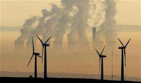 Steam rises from a power station behind the Royd Moor Wind Farm in Penistone near Sheffield, northern England, October 19, 2007. Climate experts agreed on a U.N. blueprint on Friday for fighting global warming that warns that governments only have a few years left to avert the worst impacts. REUTERS/Phil Noble