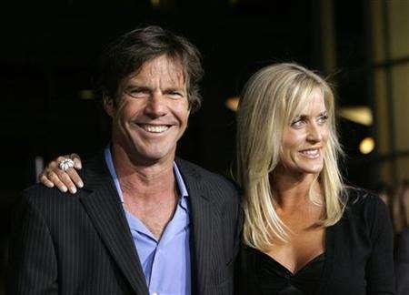 Cast member Dennis Quaid and his wife Kimberly arrive at the world premiere of ''American Dreamz'' at the Arclight Cinerama Dome in Hollywood April 11, 2006. The couple's two-week-old twins were recovering in a Los Angeles hospital on Wednesday after mistakenly being given a massive overdose of a blood thinning drug. REUTERS/Mario Anzuoni