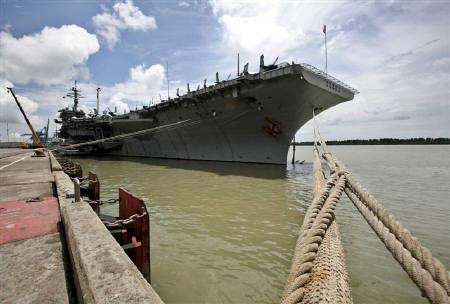 The USS Kitty Hawk carrier is anchored at Malaysia's West Port in Port Klang, outside Kuala Lumpur, in this August 28, 2007 file photo. The saga of a U.S. aircraft carrier being denied entry to Hong Kong at Thanksgiving took a bizarre turn on Thursday when China denied saying the whole affair had been a misunderstanding. REUTERS/Bazuki Muhammad
