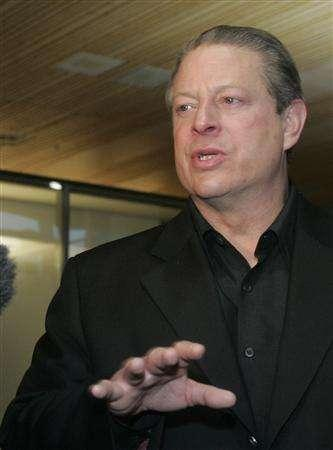 Nobel Peace Prize winner Al Gore speaks to the media in Oslo Airport December 7, 2007. Gore urged governments on Friday to advance by two years a new treaty to curb greenhouse gas emissions instead of waiting until the Kyoto pact expires in 2012. REUTERS/Ints Kalnins
