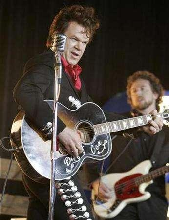 Actor John C. Reilly performs at the premiere of his film ''Walk Hard :The Dewey Cox Story'' in Hollywood, California December 12, 2007. REUTERS/Fred Prouser