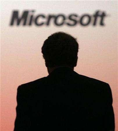 Microsoft Chairman Bill Gates is silhouetted as he walks on stage in Ottawa February 20, 2007. Portuguese company Microsoft Lda. plans to put its brand name and business up for sale on online auction site eBay on Wednesday with a starting price of $1 million (496,000 pounds), its chief executive, Ricardo Carvalho, said on Monday. REUTERS/Chris Wattie