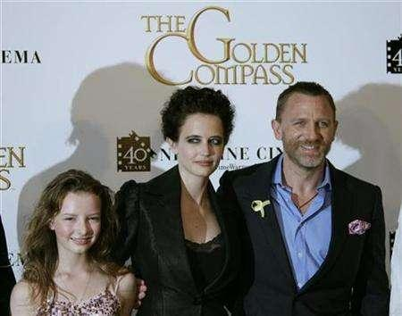 Cast members, from L-R, Dakota Blue Richards, French actress Eva Green and British actor Daniel Craig pose during a photocall for U.S. director Chris Weitz's film ''The Golden Compass'' at the 60th Cannes Film Festival May 21, 2007. REUTERS/Yves Herman