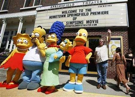 Creator of the show ''The Simpsons'' creator Matt Groening (R) waves alongside characters (L-R) Lisa, Homer, Marge, Maggie, and Bart Simpson as he arrives for the premiere of the film ''The Simpsons Movie'' in Springfield, Vermont July 21, 2007. ''The Simpsons Movie'' topped the DVD sales chart in the final week before Christmas, after a colorful promotion across the United States. REUTERS/Lucas Jackson