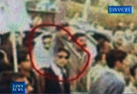 A TV frame grab taken on December 29, 2007 shows a still image taken by an amateur photographer of a suspected gunman (in sunglasses) and suspected suicide bomber (in white scarf) near Pakistani opposition leader Benazir Bhutto's vehicle (not pictured) in Rawalpindi. REUTERS/Dawn TV via Reuters TV