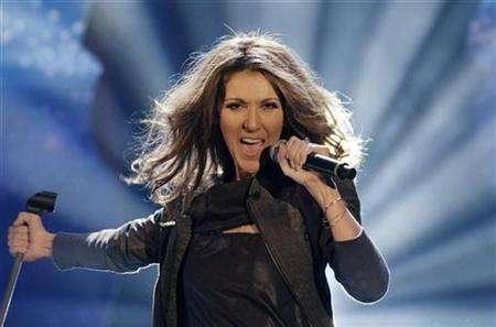 Canadian singer Celine Dion performs her song ''Taking Chances'' during Thomas Gottschalk's TV show ''Wetten, dass..?'' (Bet it..?) in the eastern German city of Leipzig November 10, 2007. Picture taken November 10, 2007. Dion will play her first concert in China in April and has submitted an entry for the Beijing Olympics theme song competition, Games organizers said on Wednesday. REUTERS/Eckehard Schulz/Pool