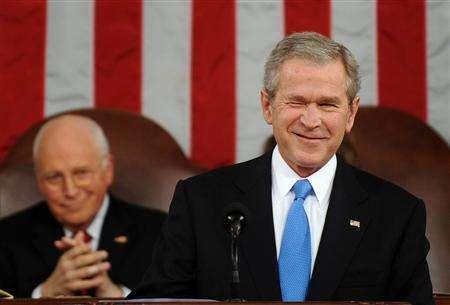 US President George W. Bush winks to a member of the audience before he delivers the final State of the Union address of his presidency at the Capitol in Washington January 28, 2008. REUTERS/Tim Sloan/Pool