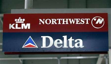 A Delta Airlines and Northwest Airlines sign hang at the arrival terminal at Detroit Metropolitan Airport in Romulus, Michigan September 14, 2005. A merger between Delta Air Lines Inc and Northwest Airlines Corp could be announced in the next few weeks as Northwest pilots review details of a proposed deal, people briefed on the situation said on Monday. REUTERS/Rebecca Cook