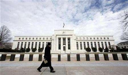 A pedestrian passes in front of the Federal Reserve Building in Washington January 22, 2008. Fear that a hobbled banking sector may set off another Great Depression could force the U.S. government and Federal Reserve to take the unprecedented step of buying a broad range of assets, including stocks, according to one of the most bearish market analysts. REUTERS/Kevin Lamarque