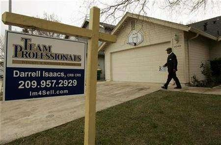A potential investor, part of a bus tour of homes that have foreclosed, is shown leaving a vacant property for sale in Stockton, California February 2, 2008. Mortgage servicers are the next victim of the housing crisis. REUTERS/Robert Galbraith
