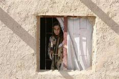 <p>Una donna sciita alla periferia di Baghdad, nel novembre 2007. REUTERS/Erik de Castro</p>