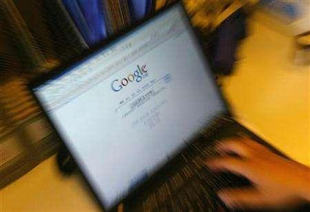 A laptop screen shows a Google homepage in this file photo dated June 8, 2006. Google said on Wednesday it is offering a simple Web site publishing tool for office workers to set up and run their team collaboration sites, taking aim at Microsoft Corp's rival SharePoint franchise. REUTERS/Jason Lee