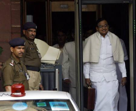 Finance Minister Palaniappan Chidambaram (R) smiles as he leaves his office to present the union budget 2008-09 in New Delhi February 29, 2008. REUTERS/Vijay Mathur