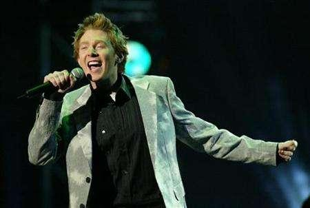 Singer Clay Aiken, an ''American Idol'' finalist performs onstage at the 31st annual American Music Awards in Los Angeles, November 16, 2003. Just as his stint starring in the Broadway hit ''Spamalot'' concludes, ''American Idol'' veteran Aiken will return with his first album of entirely new material since 2003's ''Measure of a Man.'' REUTERS/Jim Ruymen