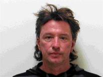<p>Il chitarrista Richie Sambora, della band Bon Jovi, in una foto segnaletica della polizia di Laguna Beach. REUTERS/Laguna Beach Police Department/Handout</p>