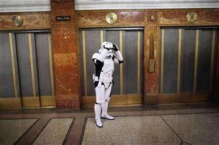 File photo shows a man dressed as a character from the movie ''Star Wars'' waiting for an elevator in the lobby of the Hotel Pennsylvania in New York November 17, 2007. REUTERS/Jacob Silberberg