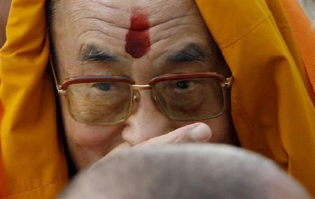 Tibetan spiritual leader Dalai Lama leaves after a prayer meeting for those who lost their lives during China's crackdown on protests in Tibet, at the memorial of Mahatma Gandhi in Rajghat, New Delhi, March 29, 2008. REUTERS/Adnan Abidi/Files