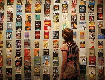 A woman looks at a collection of original 007 novels by Ian Fleming, at the ''For Your Eyes Only'' exhibition of Ian Fleming and James Bond memorabilia at the Imperial War Museum in London April 16, 2008. REUTERS/Stephen Hird
