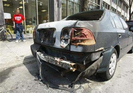 A damaged car is seen in downtown Montreal April 22, 2008. REUTERS/Shaun Best