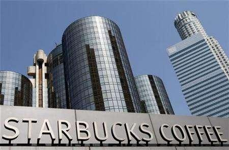 A Starbucks branch is shown in downtown Los Angeles, April 24, 2008. Starbucks Corp on Thursday took a major step back from its music and book business by handing over day-to-day management of its year-old music label to Concord Music Group, as it strives to contain costs and rejuvenate its coffee shop business. REUTERS/Lucy Nicholson