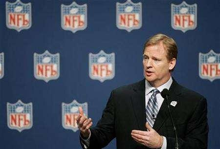 NFL commissioner Roger Goodell answers questions at a news conference in Phoenix February 1, 2008. Goodell said Thursday the football league remains committed to the NFL Network after a rough and tumble year on the distribution side. REUTERS/Jeff Haynes