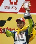 <p>Valentino Rossi festeggia la vittoria al Gran Premio di Cina. REUTERS/Nir Elias</p>