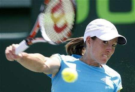 Justine Henin of Belgium eyes the ball during her match against Serena Williams of U.S. at the Sony Ericsson Open tennis tournament in Key Biscayne, Florida April 1, 2008. Henin said on Monday she had set her sights on a future of leisurely travel and adult education as a way of making all the sacrifices required of her seem worthwhile. REUTERS/Robert Sullivan