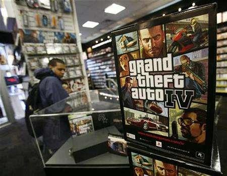 An advertisement for the ''Grand Theft Auto 4'' video game sits on display at a store in New York April 28, 2008. REUTERS/Shannon Stapleton