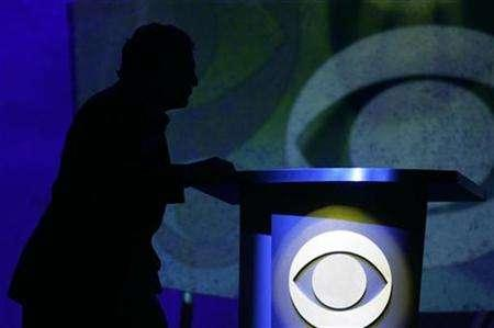 Leslie Moonves, president and CEO of the CBS Corp., watches a video during his keynote address at the 2007 International CES (Consumer Electronics Show) in Las Vegas, Nevada January 9, 2007. REUTERS/Rick Wilking