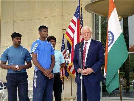 India's Dinesh Patel (L) and Rinku Singh (2nd L), winners of a nationwide baseball pitching contest, watch as U.S. ambassador to India David C. Mulford (R) speaks after handing them visas in New Delhi May 2, 2008. The two Indian teenagers are chasing an American dream as baseball professionals and their promoters hope they can stir up interest in the game in their cricket-mad homeland. Singh and fellow javelin thrower Patel began a year-long training stint in Los Angeles last week after winning an India-wide pitching contest, ''The Million-Dollar Arm''. Picture taken May 2, 2008. REUTERS/U.S. Embassy/Handout