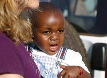 <p>David Banda, il bambino del Malawi che la cantante satunitense Madonna vuole adottare. REUTERS/Edison Chagara</p>