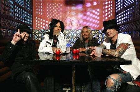 (L-R) Motley Crue's Mick Mars, Nikki Sixx, Vince Neil and Tommy Lee pose at Avalon in Hollywood, April 15, 2008. Last month, Motley Crue decided to find out. The band placed its new single, the title track from ''Saints of Los Angeles,'' for sale as a downloadable track on ''Rock Band'' well in advance of the album's release date, which has been pushed back to June 24. The only other place to obtain the track was iTunes. REUTERS/Mario Anzuoni