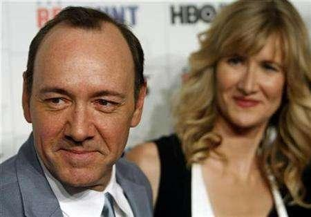 Actors Kevin Spacey and Laura Dern arrive during the premiere of ''Recount'' at the Museum of Modern Art in New York City, May 13, 2008. Florida gladly cast its vote for HBO's TV movie about the Sunshine State's recount circus after the 2000 presidential election, casting aside any worries about reliving the tumultuous period. REUTERS/Joshua Lott