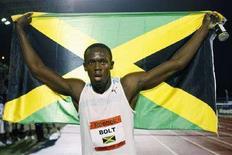 <p>Lo sprinter giamaicano Usain Bolt subito dopo la vittoria. REUTERS/Gary Hershorn (UNITED STATES)</p>