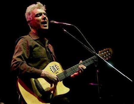 File photo shows musician David Byrne performing at the Luna Park theatre in Buenos Aires, October 14, 2004. REUTERS/Marcos Brindicci