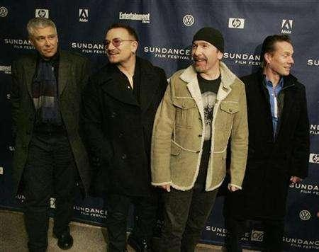 Members of the band U2 (L-R) Adam Clayton, Bono, The Edge and Larry Mullen pose for photographers as they arrive for the premiere of ''U2 3D'' the first digital 3D concert film by directors Catherine Owens and Mark Pellington at the 2008 Sundance Film Festival in Park City, Utah January 18, 2008. REUTERS/Fred Prouser