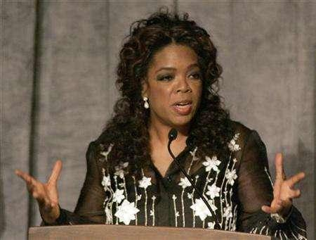 Media mogul Oprah Winfrey gestures as she introduces Archbishop Desmond Tutu during a reception to honor him being awarded the Lincoln Leadership Prize Chicago, Illinois May 13, 2008. REUTERS/Frank Polich