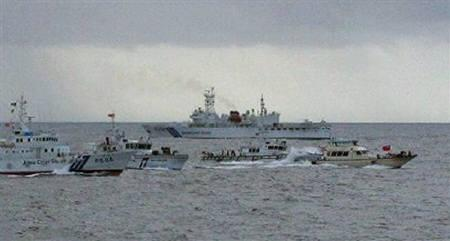 Japanese Coast Guard ships are pictured with a Taiwanese vessel (R) heading for the disputed islands in the East China Sea known as the Senkaku isles in Japanese, Diaoyu in Chinese, and Tiaoyutai in Taiwan June 16, 2008. REUTERS/Japan Coast Guard/Handout