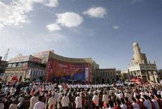 <p>La cerimonia del passaggio della torcia a Kashgar, nella provincia del Xinjiang. REUTERS/Reinhard Krause</p>