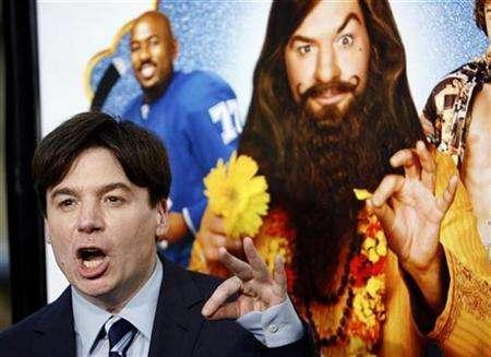 Cast member Mike Myers gestures at the premiere of ''The Love Guru'' at the Grauman's Chinese theatre in Hollywood, California June 11, 2008. REUTERS/Mario Anzuoni
