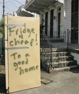A refrigerator sits on the sidewalk of New Orleans September, 30, 2005. REUTERS/ Charles W. Luzier