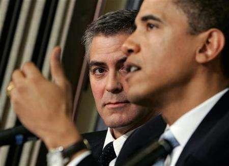 Academy awarding-winning actor George Clooney (L) looks on as Senator Barack Obama (D-IL) speaks about the Darfur region of Sudan, in Washington April 27, 2006. REUTERS/Jason Reed