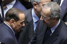 <p>Italian Prime Minister Silvio Berlusconi (L) speaks with PD leader Walter Veltroni during a vote of confidence at the lower house of Parliament in Rome May 14, 2008. REUTERS/Max Rossi (ITALY)</p>