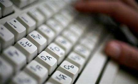 An employee types on a computer keyboard with both Latin and Cyrillic letters in Sofia June 23, 2008. Bulgaria applied on Monday to register an Internet domain name in Cyrillic script as part of efforts to boost national pride amid a growing influence of English. REUTERS/Stoyan Nenov