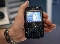 <p>A hostess holds the Motorola Q9 mobile at the 3GSM World Congress in Barcelona February 15, 2007. REUTERS/Albert Gea</p>