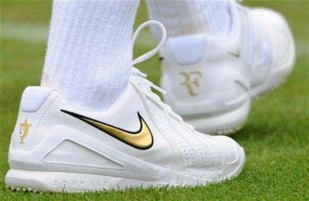 Detail is seen on the back of Switzerland's Roger Federer's shoe as he trains on the practice courts at Wimbledon, ahead of the Wimbledon championships in south London June 21, 2008. REUTERS/Toby Melville